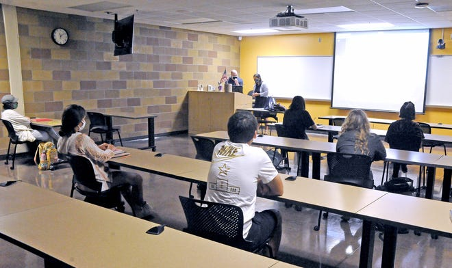 "Students sit far apart in Associate Professor's Heather Howley's ""Introduction to Communication"" class at Wayne College on Aug. 26."