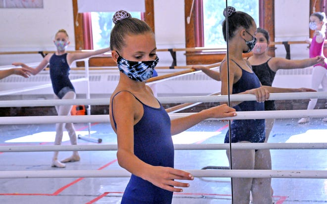 Elise Wigal uses a bar during an exercise in a junior ballet class Tuesday afternoon at the Wayne Center for the Arts.