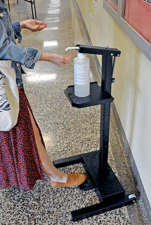 There are many foot operated sanitizing stations located throughout the school buildings.  The sanitizer and the stands were made by a local company in Wooster.