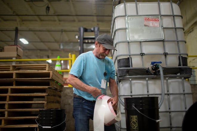 David Snodgrass prepares to package a product at a new manufacturing facility for  the Columbia-based chemical fluids manufacturer Froggy's Fog in Mt. Pleasant, Tenn., on Tuesday Aug. 25, 2020.