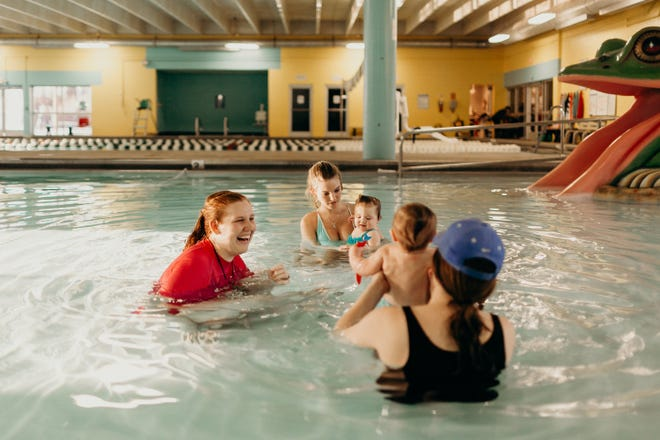 Visitors swim inside the indoor pools at Muletown Rec during a swim class for young children offered by the facility located in Columbia, Tenn.