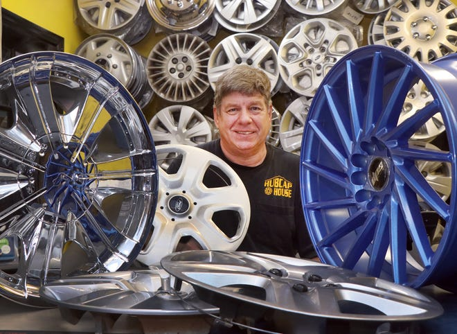 Richie Lukac, owner of the Hub Cap House, is surrounded by custom alloy wheels and hubcaps at the business in Holly Hill. Hubcap House has been a fixture on Nova Road for 35 years.
