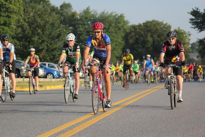 Cyclists typically take off in a mass start during the Amish Country Bike Tour, like this race captured in 2018. This year, the start times will be staggered to protect people's health.
