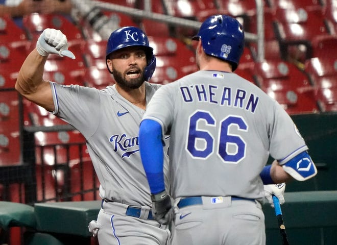 Kansas City Royals first baseman Ryan O'Hearn (66) is congratulated by teammate Ryan McBroom after hitting a solo home run to tie it 4-4 in the sixth inning of Tuesday's game in St. Louis. McBroom later drove in the winning run in the eighth inning as the Royals edged the Cardinals 5-4.