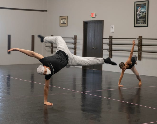 Hudson Conservatory of Ballet staff instructor Antonio Morillo wears a mask in a private lesson with Maggie Crookston. The ballet studio is hosting classes with safety precautions during the COVID-19 pandemic.