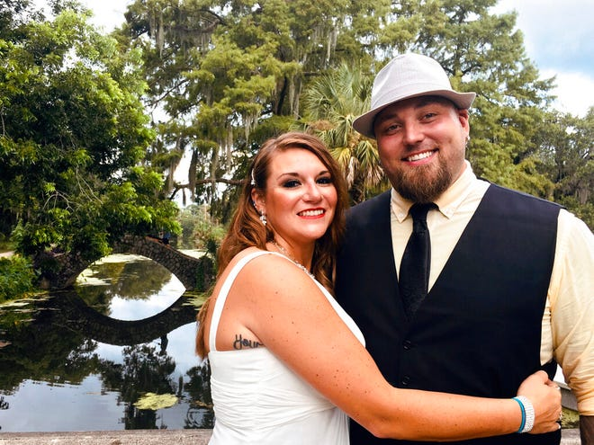 This image released bu Jordan Tyler shows Tyler, right, with his wife Brittany in New Orleans on July 18, 2020. The couple signed up for Match.com, started texting March 18 and were wed by July. (Jordan Tyler via AP)