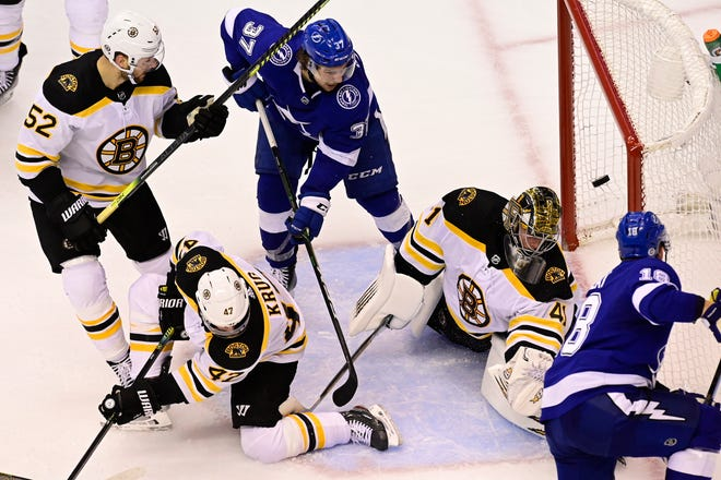 Tampa Bay Lightning left wing Ondrej Palat (18) scores the winning goal on Boston Bruins goaltender Jaroslav Halak (41).