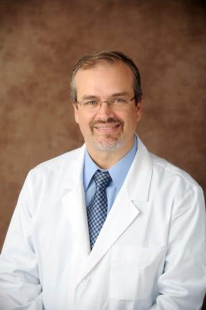 Dr. Eduardo Oliveira, executive medical director for critical care services for AdventHealth Central Florida.