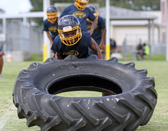 Winter Haven players go through conditioning drills on the first day of practice on Wednesday afternoon on the first day of football practice. Football players must have five days of practice before they are allowed to practice in pads. ROY FUOCO/THE LEDGER