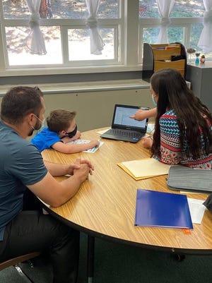 Dunsmuir Elementary School second/third grade teacher Jessica Hatten shows Landon Martin and his dad how to navigate Google Classroom.