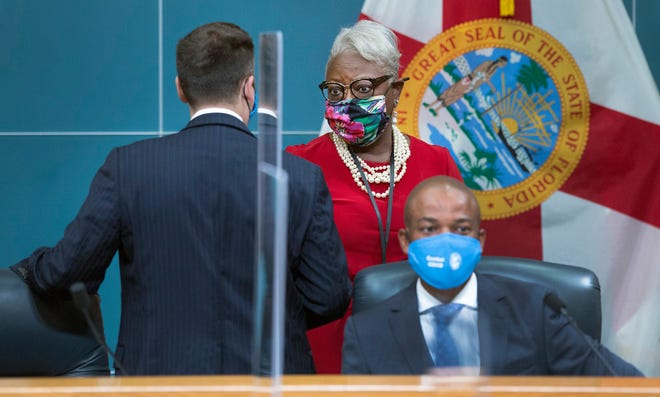 County administrator Verdenia C. Baker speaks to county mayor Dave Kerner, left, before the Palm Beach County Commission meeting Tuesday where a Phase 2 of reopening was discussed.  At right is commissioner Mack Bernard?. [LANNIS WATERS/palmbeachdailynews.com]