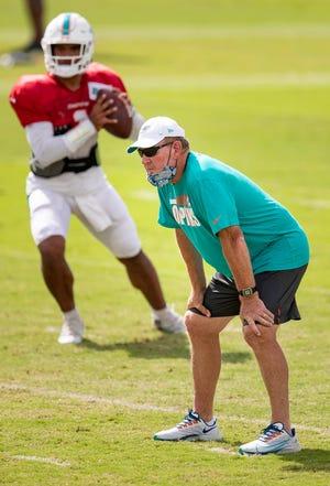 Dolphins offensive coordinator Chan Gailey watches drills involving quarterback Tua Tagovailoa.