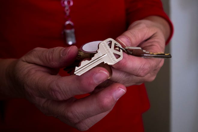 Palm Beach County will reopen applications for COVID-related rent and utility assistance in March. In this 2017 file photo, a woman receives keys to a newly renovated affordable rental home. (CALLA KESSLER/The Palm Beach Post)
