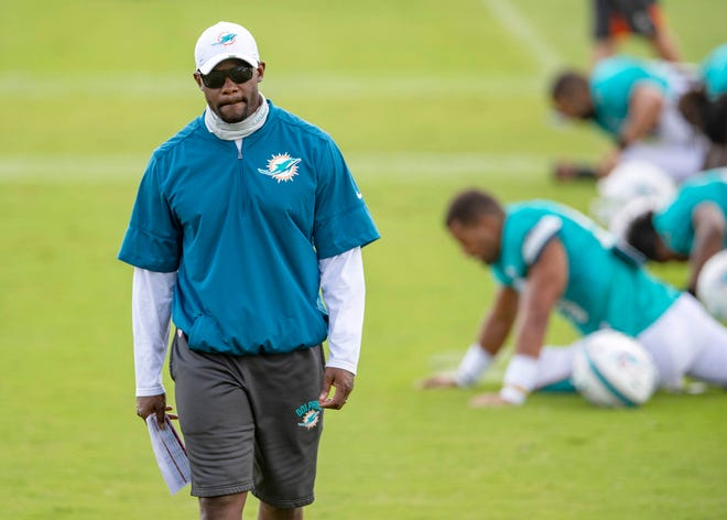 Head coach Brian Flores is seen at Dolphins training camp in August.