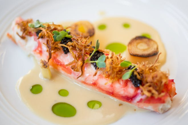Butter-poached king crab leg with caviar, leeks, lemon and roasted garlic butter at Lionfish. The San Diego-born restaurant debuts in Delray Beach this spring. [Provided by Clique Hospitality]