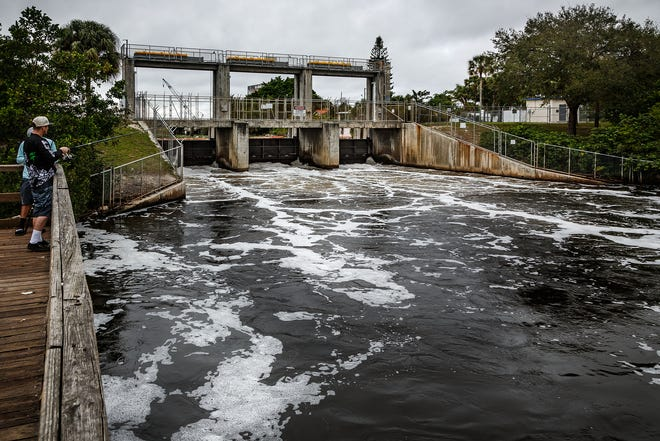 About eight thousand gallons per second of water flows through the South Florida Water Management District's Control Structure S-155 on Canal C-51 in Spillway Park east of Dixie Highway near the Lake Worth and West Palm Beach, Fla. city limits on February 1, 2016. SFWMD is moving water to control canal levels after unprecedented rainfall in the last few months in south Florida. (Thomas Cordy / The Palm Beach Post)