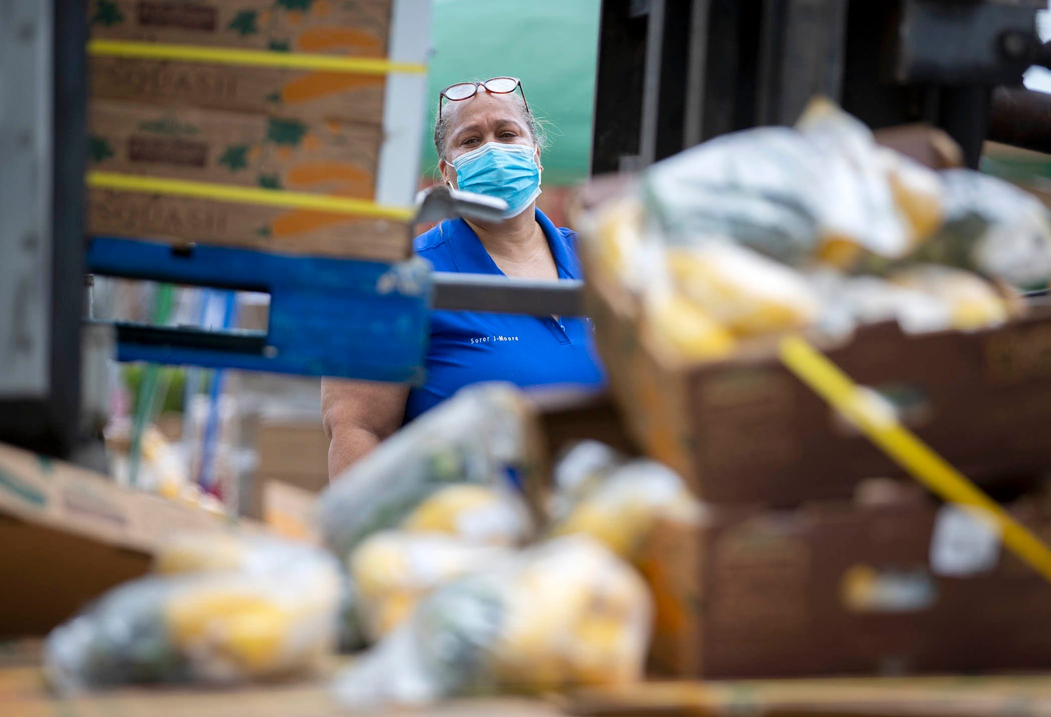 Tammy Jackson Moore helped start, the non-profit, Guardians of the Glades. Every Friday she coordinates in one of the tri-city area centers a food distribution and coronavirus testing site. She helped distribute 100,000 pounds of food in South Bay, July 24, 2020.