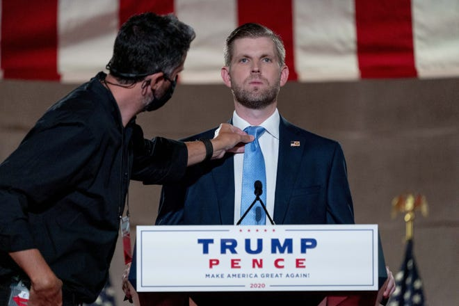 Eric Trump, the son of President Donald Trump, has his tie adjusted before taping his speech for the second day of the Republican National Convention from the Andrew W. Mellon Auditorium in Washington on Tuesday. (AP Photo/Andrew Harnik)