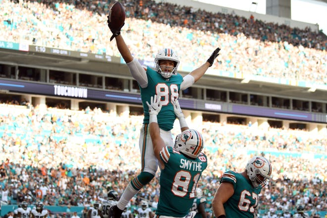 Dolphins tight end Mike Gesicki celebrates a touchdown against the Eagles with Durham Smythe. [JIM RASSOL/The Palm Beach Post]