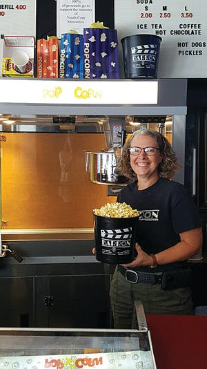 Barron Theatre Manager Patty Fox is ready with a bucket of hot, buttered popcorn, which is a popular choice by theater-goers. Carry-out bags of popcorn are also available for curbside delivery from 5 to 6 p.m. and 7:15 to 8 p.m.  Fridays, phone 620-388-5236.