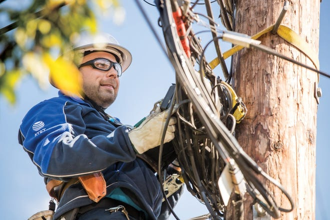 AT&T fiber lineman works on a site where the theft of copper cable occurred.