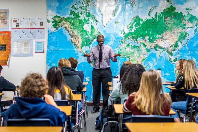 John Prothro, a social studies teacher at Perry High School, near Phoenix, Ariz., teaches a class on underrepresented heroes of history, in 2020.