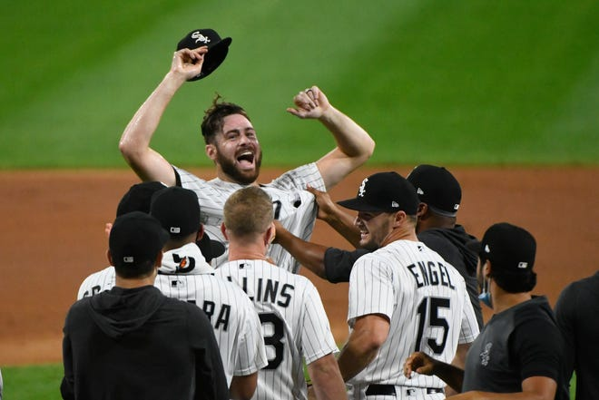 Chicago White Sox starting pitcher Lucas Giolito, facing camera, and teammates celebrate his no-hitter in a baseball game against the Pittsburgh Pirates on Tuesday. [AP Photo/Matt Marton]