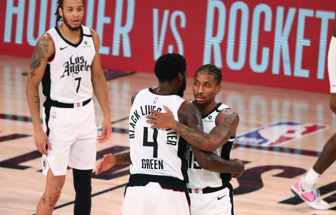 Los Angeles Clippers guard Rodney McGruder (19) and forward JaMychal Green (4) celebrate after the Clippers defeated the Dallas Mavericks in Game 5 of an NBA basketball first-round playoff series on Tuesday. [Kim Klement/Pool Photo via AP]