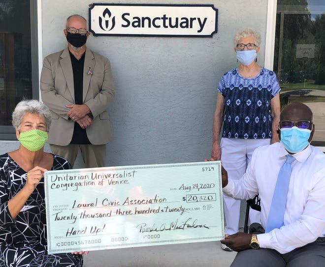 Left to right: Unitarian Universalist Congregation of Venice President Pamela MacFarlane, the Rev. Khleber Van Zandt and member Rosemary Hagen deliver a $20,320 donation to Michael Fluker, executive director of the Laurel Civic Association, for its new Hand Up program.