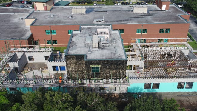 Hoar Construction is building a new Encompass Health Rehabilitation Hospital of Sarasota, 6400 Edgelake Drive, by placing a hurricane-strength shell over the previous facility that allows the hospital to continue inpatient services.