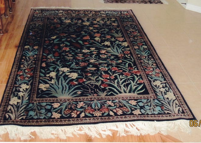 This area rug, made in Iran more than 50 years ago, is not old enough for those looking for antique Oriental rugs and carpets. [Special to The Sun]