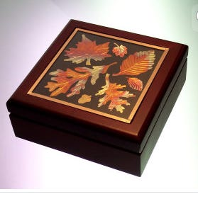 Malgorzata's Gallery will feature copper coasters and boxes by Jennifer Carson through September.