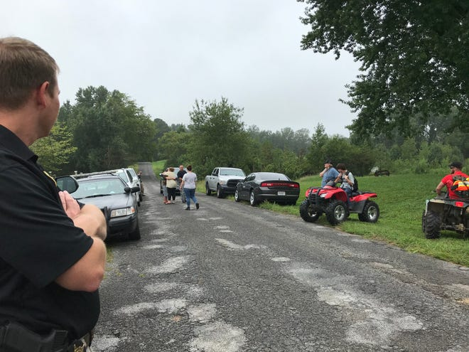 Etowah County investigator Stephen Hooks, Capt. Bob Vosbury and volunteers watched as a boy missing overnight was reunited with his mother on New Home Road.