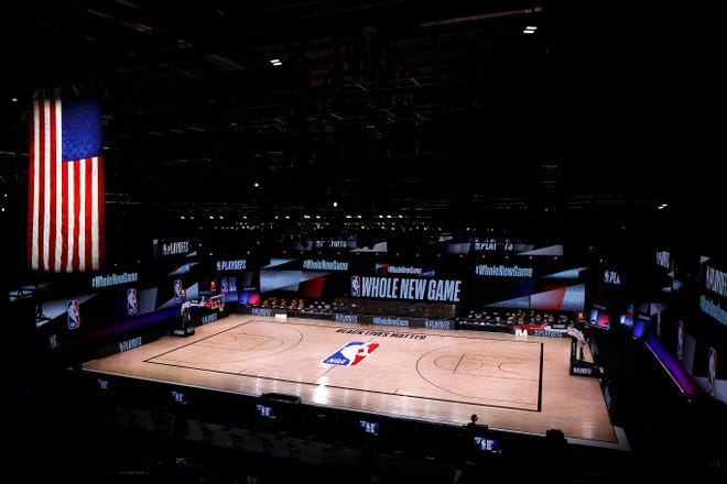 An empty court and bench is shown following the scheduled start time in Game 5 of the Eastern Conference First Round between the Milwaukee Bucks and the Orlando Magic during the NBA playoffs.