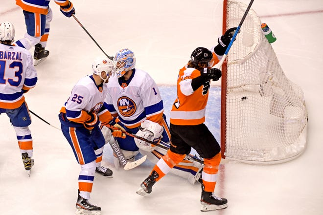 Flyers center Sean Couturier celebrates the game-winning goal by defenseman Philippe Myers against Islanders goaltender Thomas Greiss (1) during overtime in Game 2.