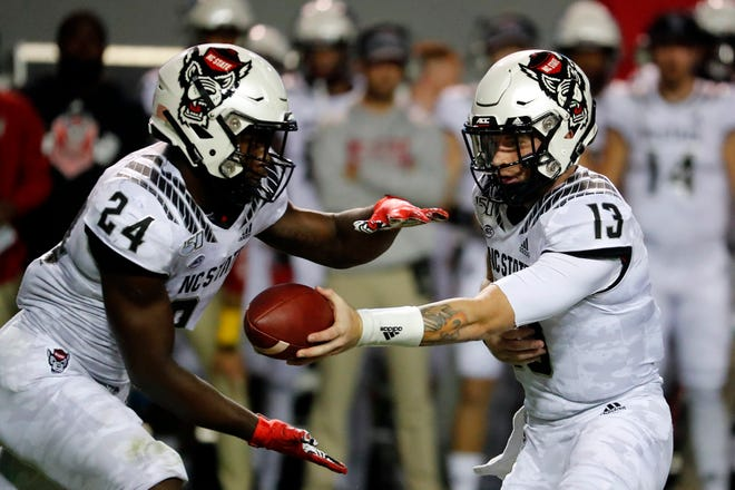 Running back Zonovan Knight, left, and quarterback Devin Leary, right, will wait an extra week for N.C. State's football season to start.