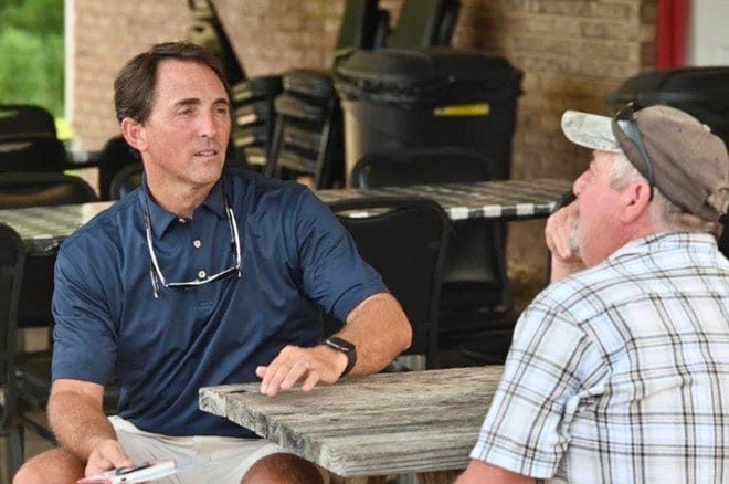 Joe Barger, at left, seen speaking to a voter during a campaign kick-off meeting at Henry's Burgers and Cream in Brookwood, was elected the new mayor of Brookwood on Tuesday, besting two challengers with more than 50 percent of the vote and avoiding the need for a runoff.
