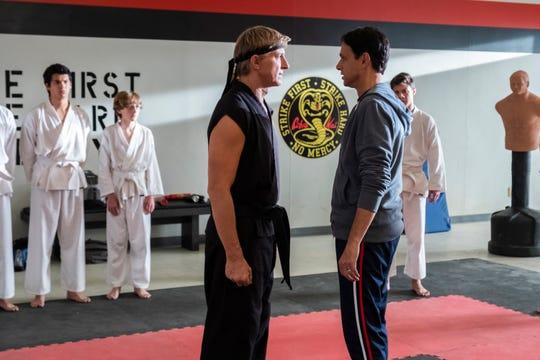 "William Zabka, left, and Ralph Macchio in a scene from ""Cobra Kai,"" now streaming on Netflix."