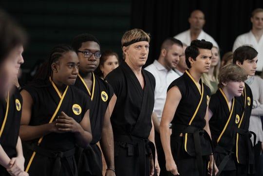 "William Zabka, center left, and Xolo Mariduena, center right, in a scene from the first season of ""Cobra Kai,"" now streaming on Netflix."
