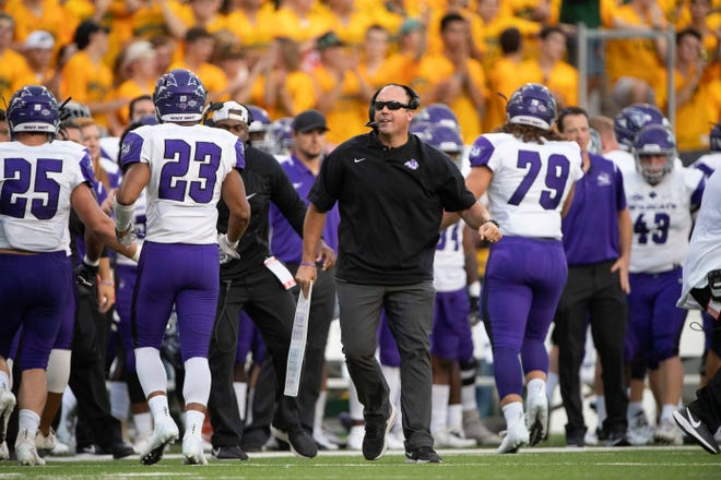 Abilene Christian coach Adam Dorrel paces the sidelines during the Wildcats' game against the Baylor Bears on Sept. 1, 2018, at McLane Stadium in Waco.