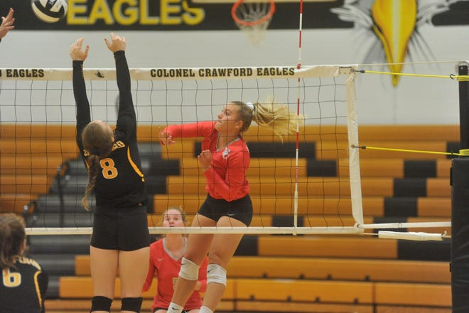 Buckeye Central's Kendra Ackerman smashes a ball across the net past Colonel Crawford's Alyssa Sallee.