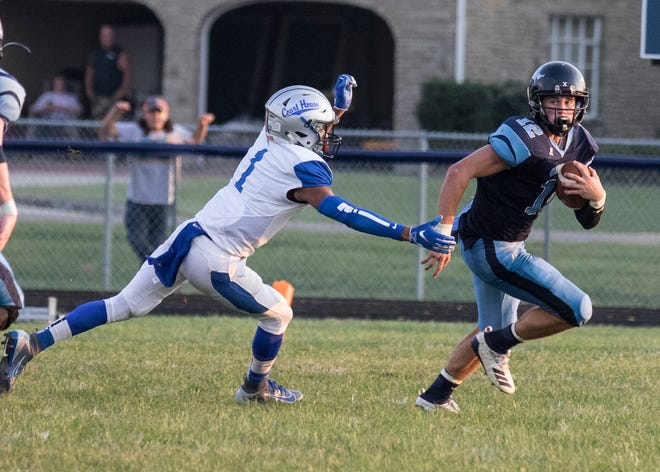 Adena's Preston Sykes avoids a tackle as he runs the ball to score against Washington Courthouse in 2019. Adena defeated Courthouse 39-18.