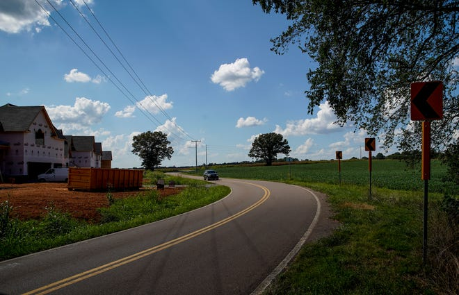 The winding Kirkwood bends around a corner and towards the outer stretches of a housing development along Kirkwood Road in Clarksville, Tenn., on Tuesday, Aug. 25, 2020.