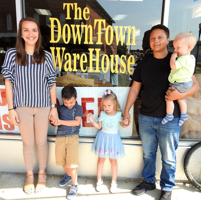 Rebecca and Jaylob Braxton with their children Jericho, 5, Gemma, 3, and Teddy, 1, outside the DownTown Warehouse on Main Street. Major items at the buy-sell-trade store include firearms, electronics and tools.