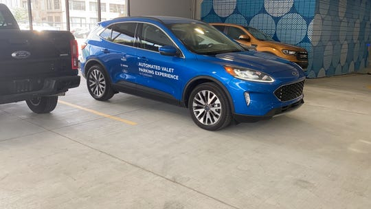 A Ford Escape with already available features parks itself in a Detroit parking structure.
