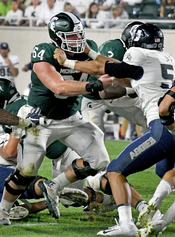 Michigan State offensive lineman Matt Allen (64) plans to play his final season with the Spartans, whenever it takes place.