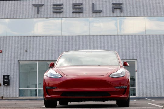 An unsold 2020 Model 3 sedan sits at a Tesla dealership late Sunday, Aug. 9, 2020, in Littleton, Colo.