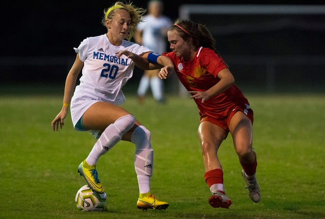 Memorial's Ryleigh Anslinger (20) controls the ball with pressure from Mater Dei's Lexi Kassenbrock (5) as the Memorial Lady Tigers play the Mater Dei Lady Wildcats Tuesday evening, Aug. 25, 2020.