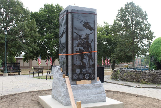 An 8-foot, 18,000-pound, four-sided polished granite panel column with military-related etchings was delivered to Sandusky County Veterans Memorial Park Wednesday morning. The Sandusky County Veterans Memorial Committee raised $64,000 for the monument honoring county veterans.