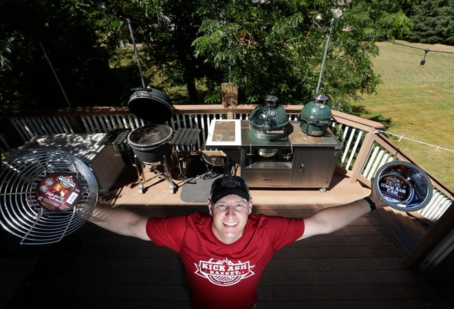 Kick Ash Basket inventor Chad Romzek shows off two of the company's best-selling products designed for the Big Green Egg that makes it easier to remove ash from the charcoal-fueled grills.